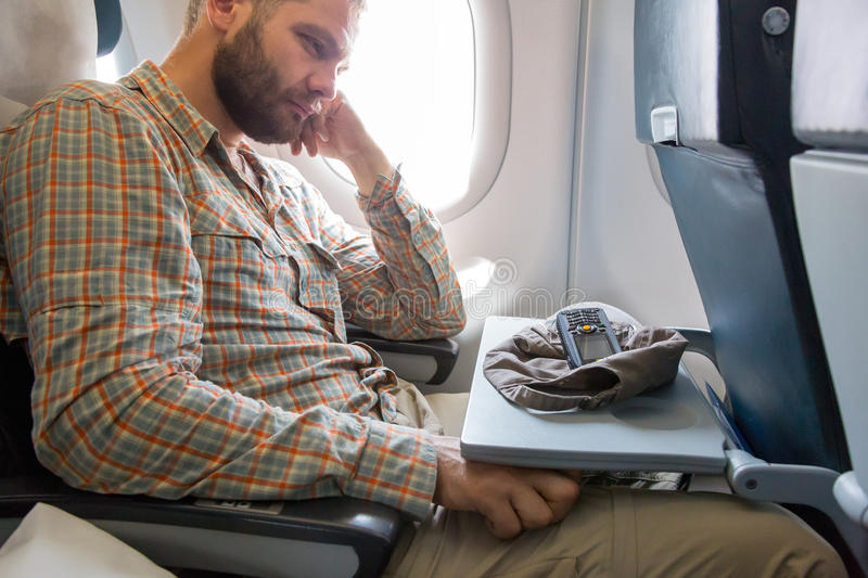 Tired Traveler at Airplane Passenger Chair royalty free stock photography