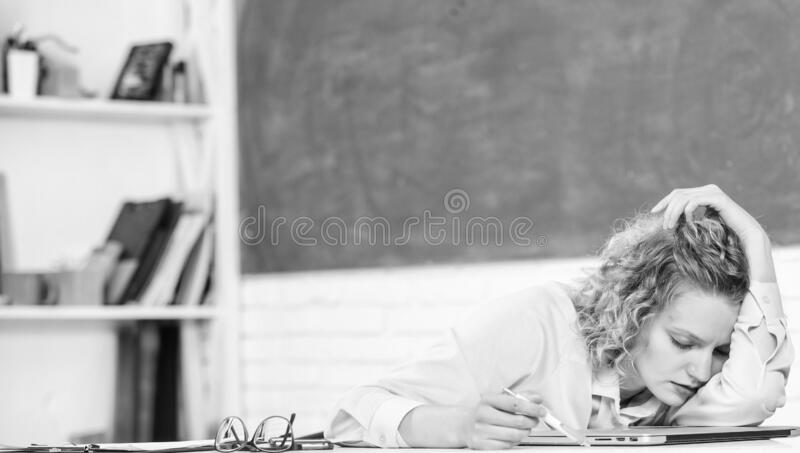 Tired tutor fall asleep at workplace. Tired student lean on desk. Exhausting lesson. Teacher exhausted after hard royalty free stock photos