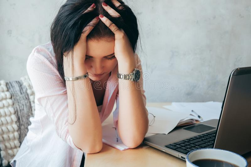 Tired upset young businesswoman suffering from strong chronic headache migraine or memory loss at work, stressed dizzy fatigued royalty free stock photography