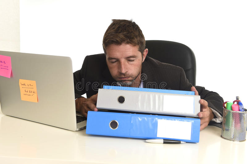 Tired wasted businessman working in stress at office laptop computer exhausted overwhelmed stock photography