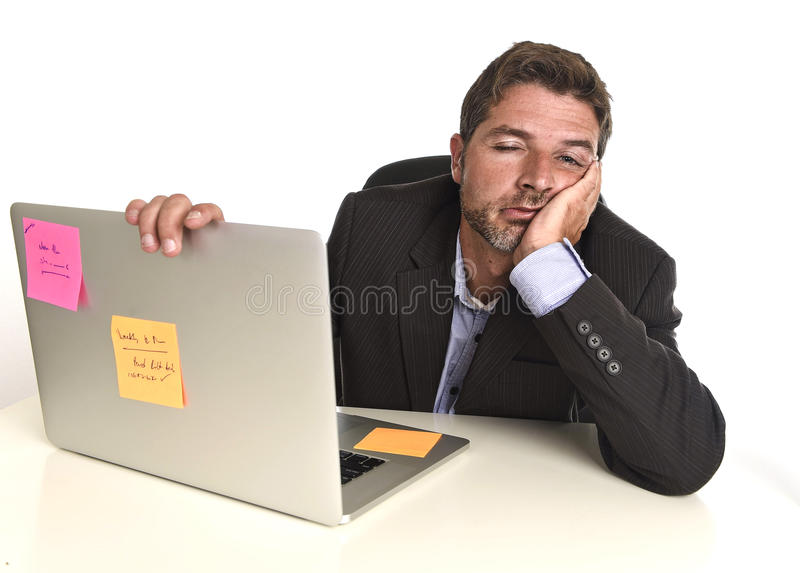 Tired wasted businessman working in stress at office laptop computer exhausted overwhelmed stock image