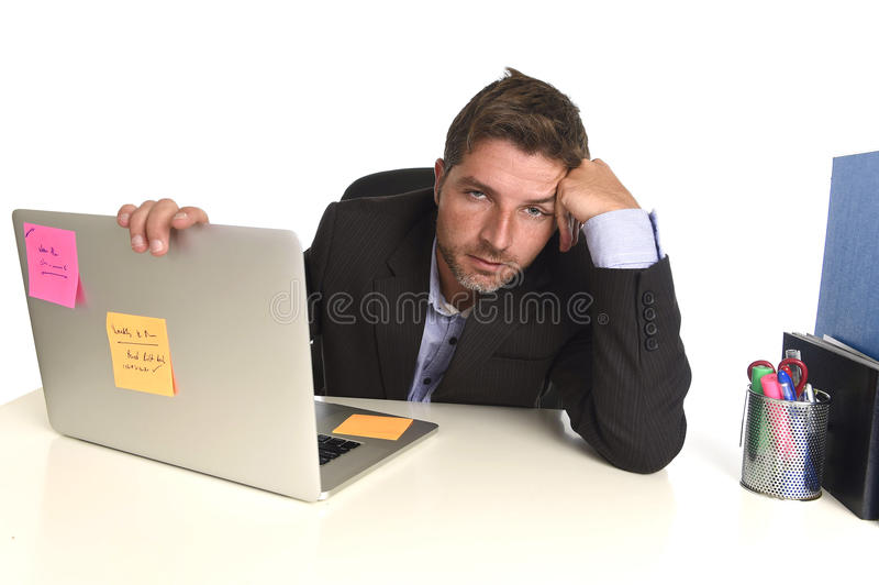 Tired wasted businessman working in stress at office laptop computer exhausted overwhelmed stock images