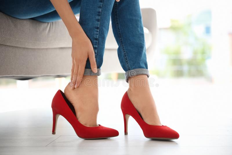 Tired woman with beautiful legs taking royalty free stock image