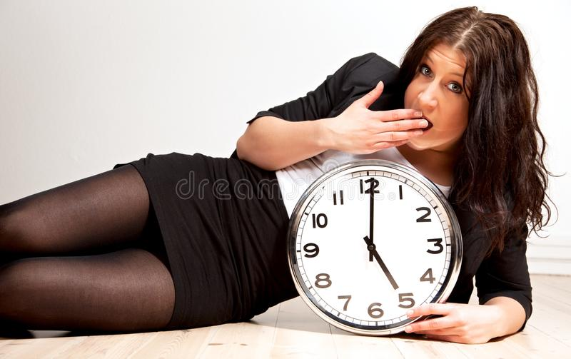 Download A Tired Woman Holding A Clock Stock Photo - Image: 24347844