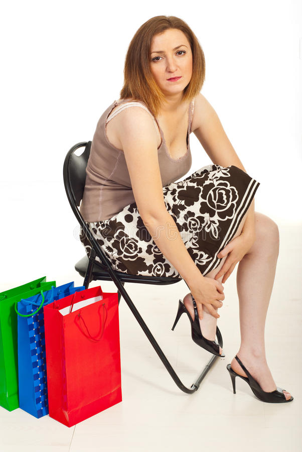Tired woman with hurting legs royalty free stock photo