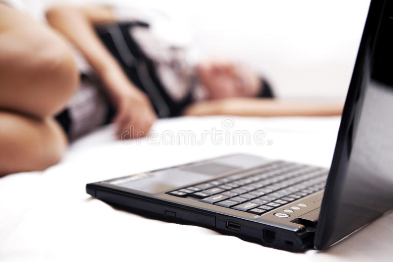 Tired woman with laptop stock photos