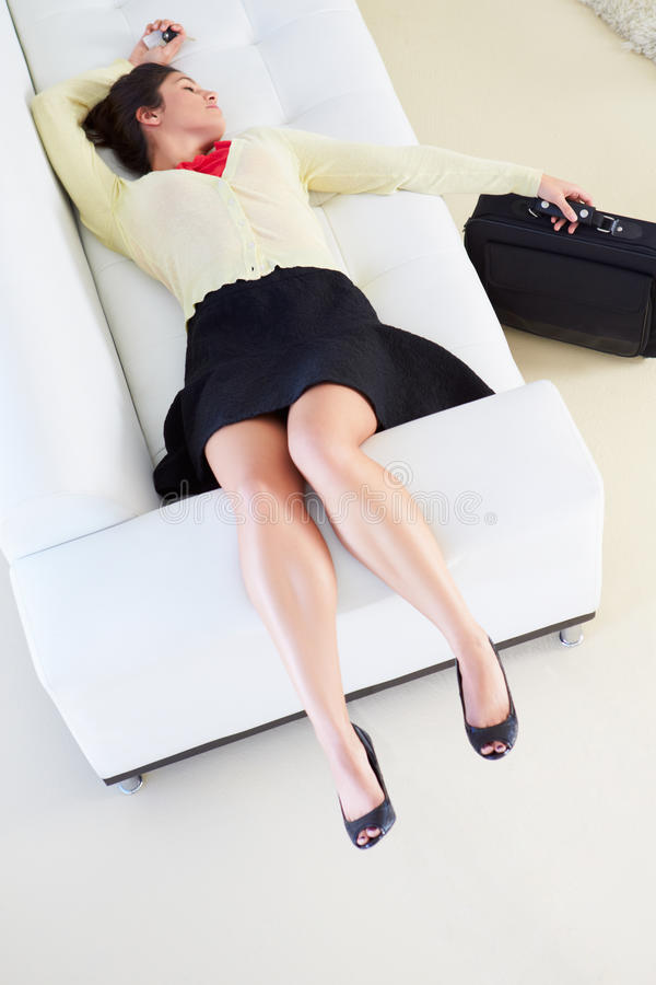 Download Tired Woman Lying On Sofa After Returning From Work Stock Photo - Image: 31345374