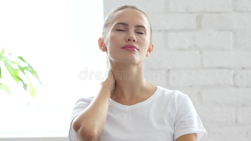 Tired Woman Relaxing Her Neck Muscles at Work, Portrait stock images
