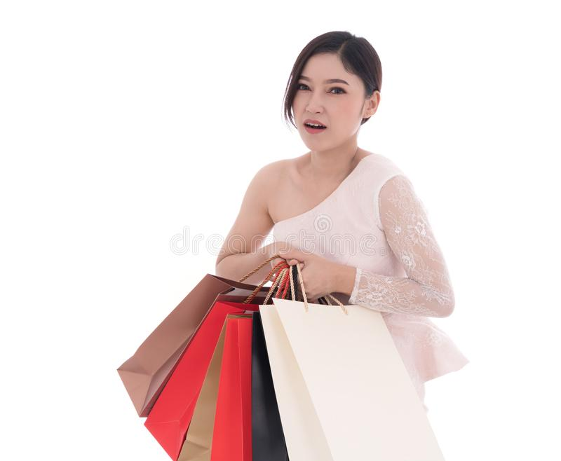 Tired woman with shopping bags isolated on white background. Tired woman with shopping bags isolated on a white background stock image