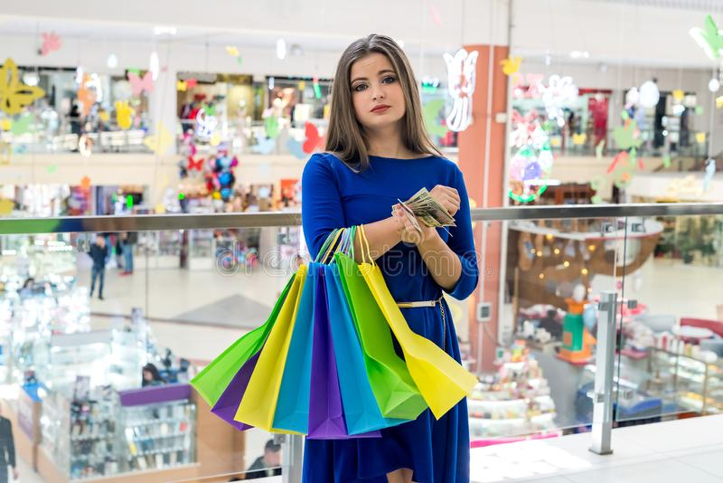 Tired woman from shopping with dollars and card.  royalty free stock photos