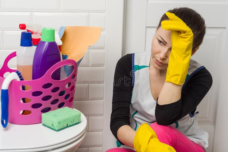 Tired Woman Sitting On Bathroom Floor With Cleaning Supplies And - Supplies for cleaning bathroom