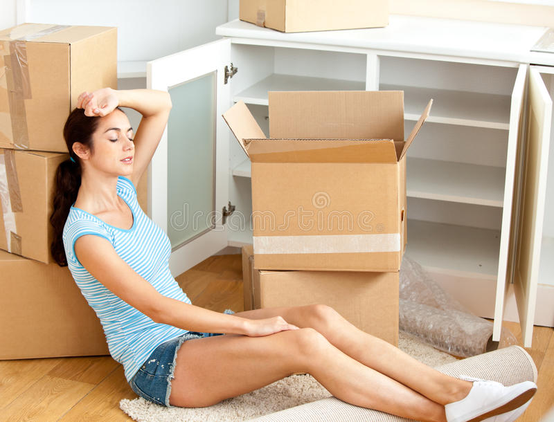 Download Tired Woman Sitting On The Floor After Unpacking Stock Photo - Image: 16263442