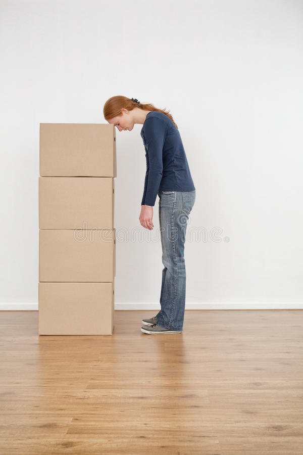 Download Tired Woman With A Stack Of Boxes Stock Photo - Image: 37705276