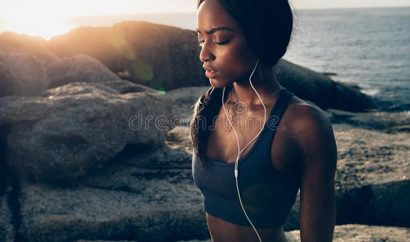 Tired woman taking break after intense workout royalty free stock photography