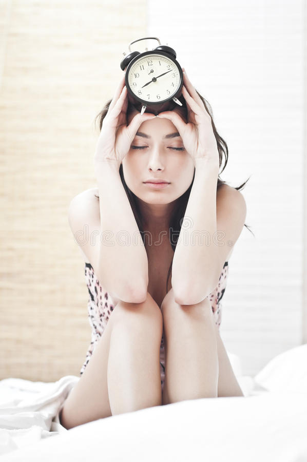 Download Tired Woman With Thealarm  Clock Stock Photo - Image: 21964186