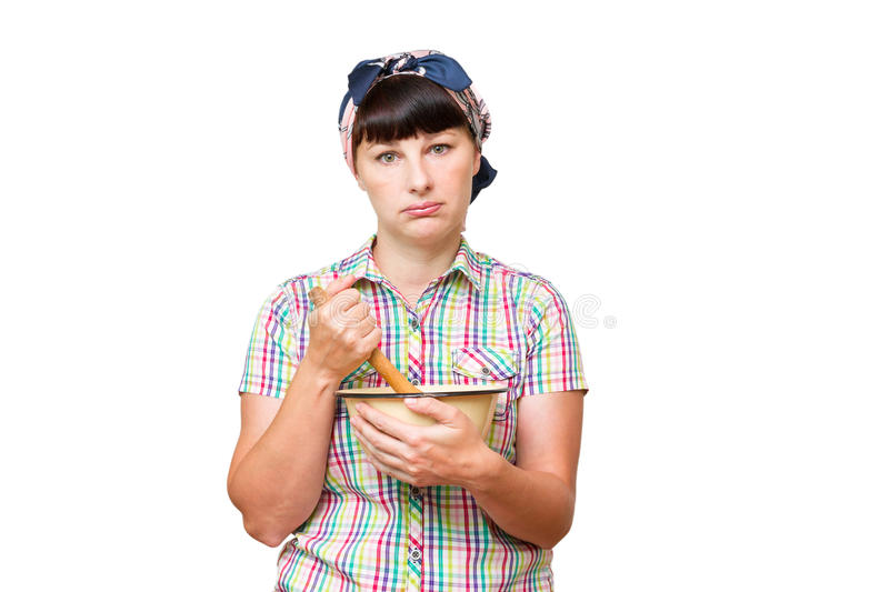 Tired woman with utensils in hand on white background. royalty free stock photos