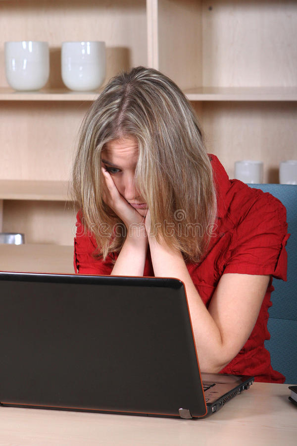 Tired at work. Woman who is very tired at the office stock photos