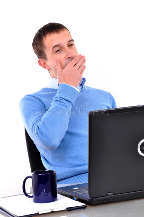 Tired young businessman royalty free stock photography
