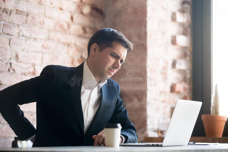 Man have a back pain at work stock photography