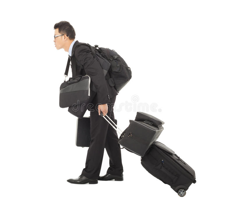 Tired young businessman pulling and belongings stock photo