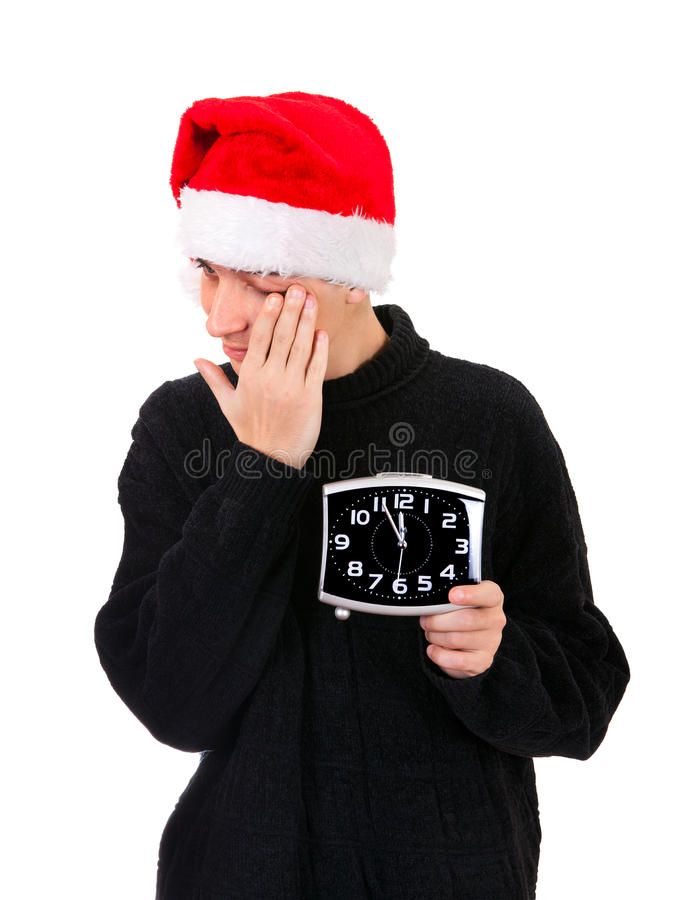 Tired Young Man with the Clock stock image