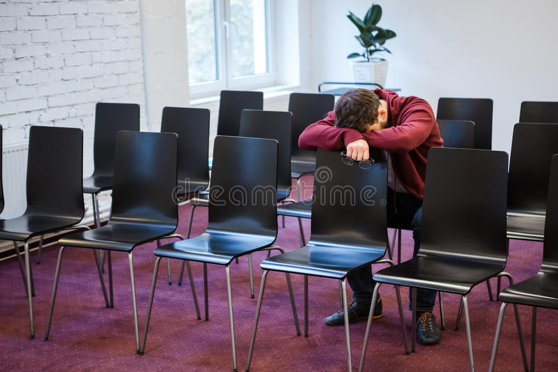 Tired young man snoozed in conference room royalty free stock photos
