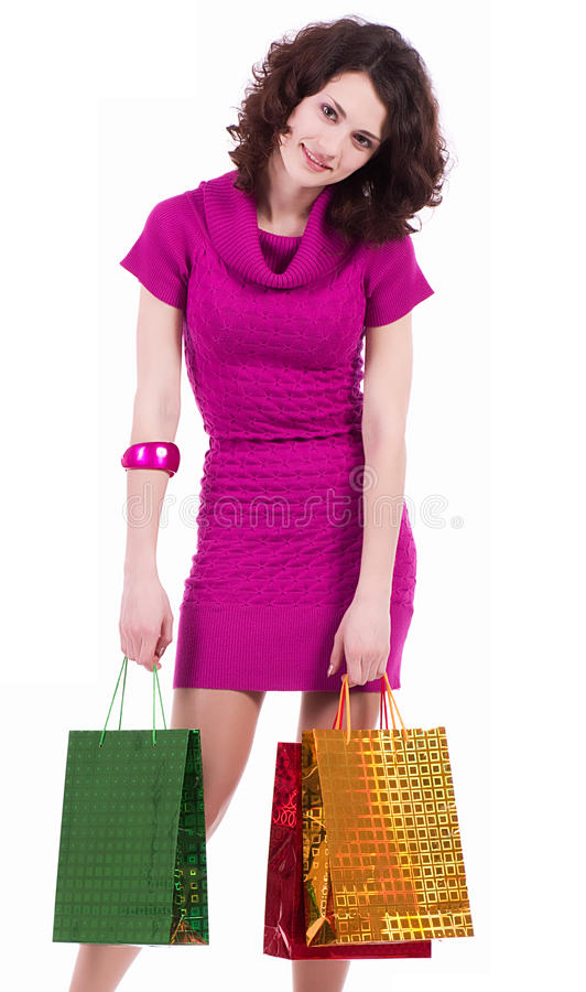 Tired young woman. With shopping bags royalty free stock photo