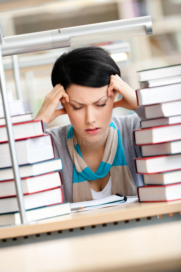 Download Tired Young Woman Surrounded With Books Stock Photo - Image: 28493946