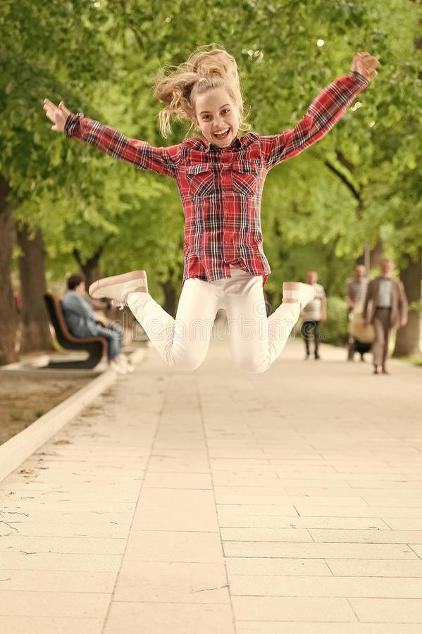 Tireless and energetic activity. Small child jumping in casual fit for physical activity. Active child enjoying playing stock photos