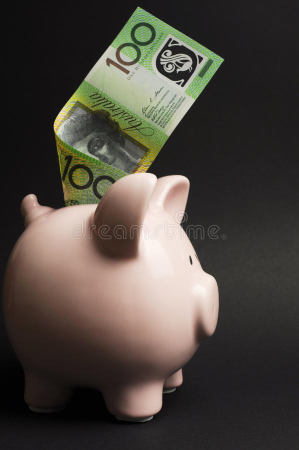 Tirelire avec l'Australien cent notes du dollar - verticale. photo stock