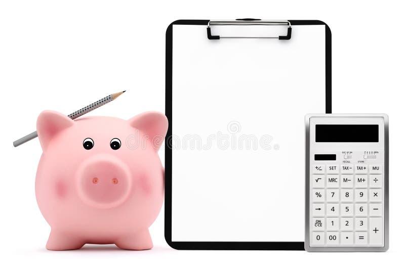 Tirelire avec le concept de comptabilité de presse-papiers de crayon de calculatrice a image libre de droits