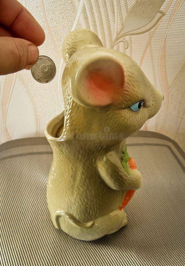Tirelire de souris pour l'argent photo stock