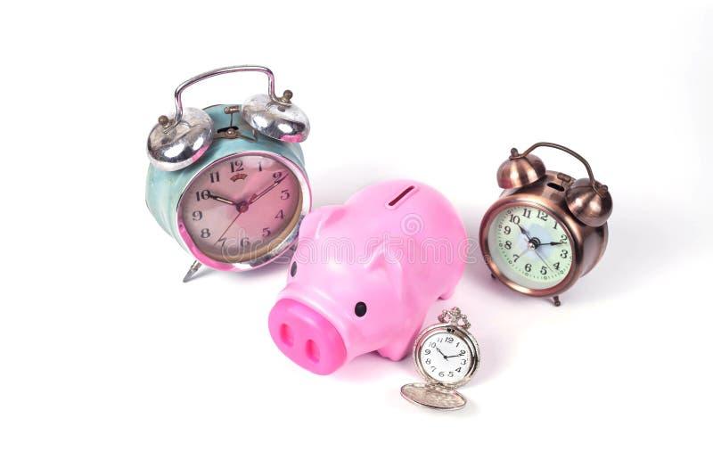 tirelire et horloge dans le temps d'économies photographie stock