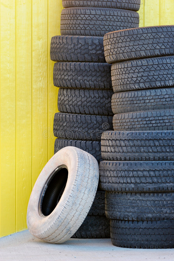 Download Tires against yellow wall stock photo. Image of many, rubber - 6394392