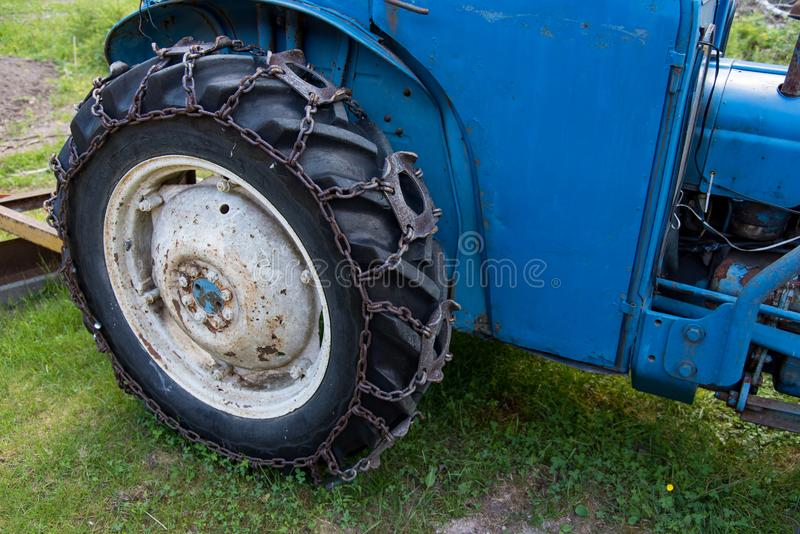 Tires on a blue tractor standing i gras. In sweden june 2018 stock images