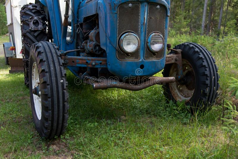 Tires on a blue tractor standing i gras. In sweden june 2018 royalty free stock photography