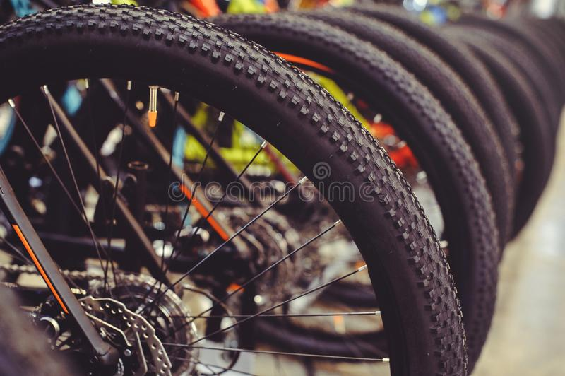 Tires Mountain bike wheel rear end stand in a row. Part of the mountain bike is a tire in close range royalty free stock photos
