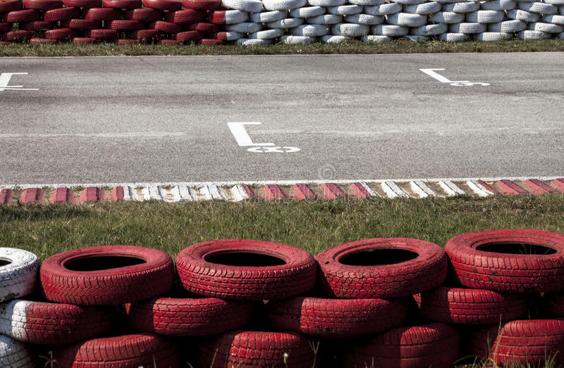 Tires on track. Go-kart track with old tires royalty free stock photo