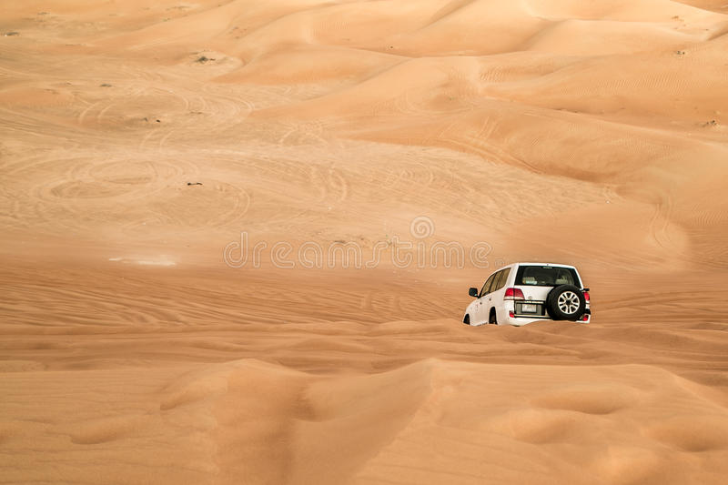 Tires tracks on sand dunes. Dune bashing tracks in UAE desert stock images