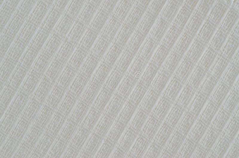 Tiro ascendente cercano toalla blanca de la tela de la sola fotografía de archivo