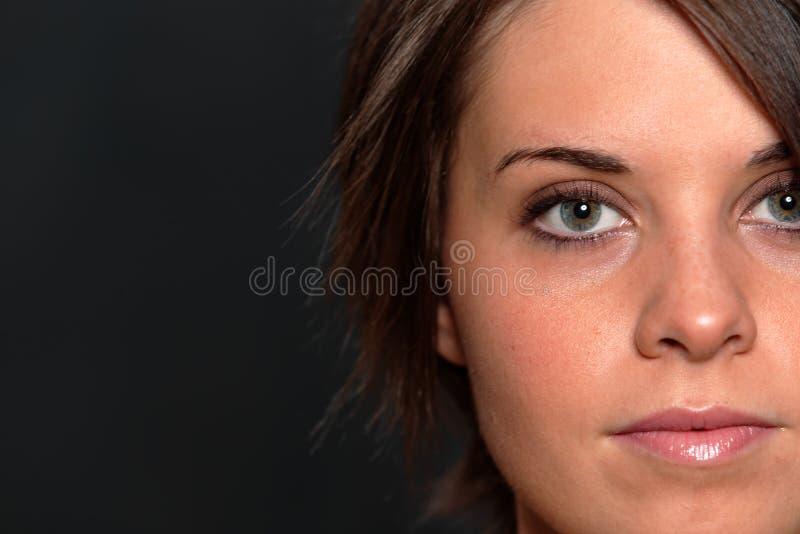 Tiro da face da mulher nova foto de stock