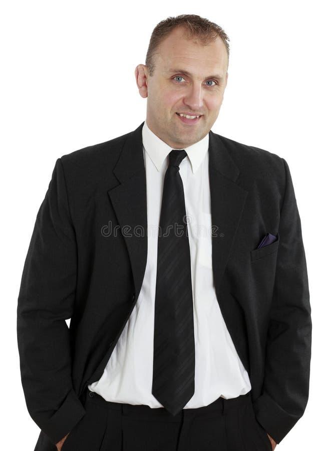 Tiro do estúdio de um homem em um revestimento e em um laço isolados no branco imagem de stock