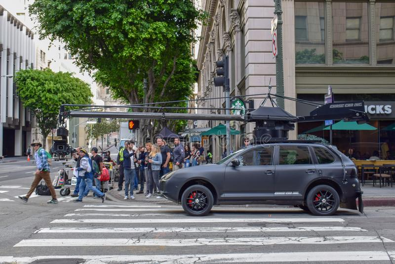 Tiro do filme de ação em Los Angeles do centro com carro da câmera imagens de stock royalty free