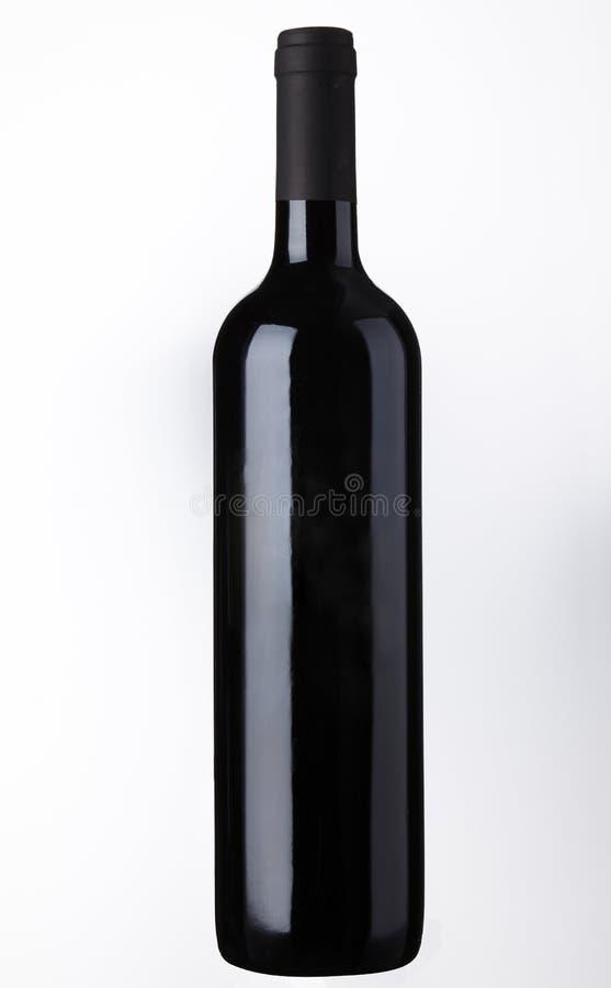Tiro do frasco de vinho vermelho imagens de stock royalty free