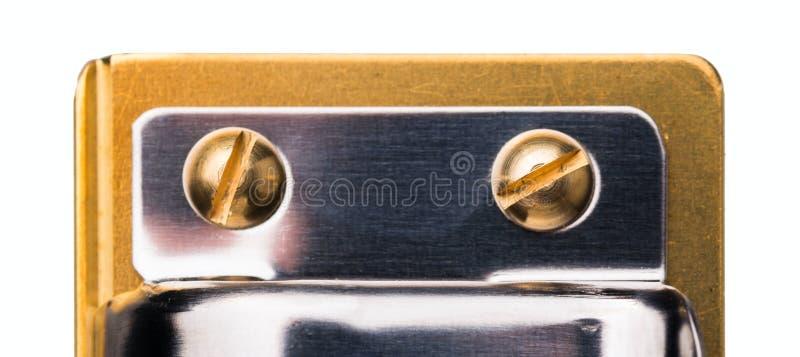 Tiro macro de las cabezas de un tornillo oro-revestidas fotografía de archivo