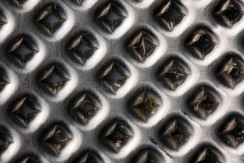 Tiro macro do grater do cromo foto de stock