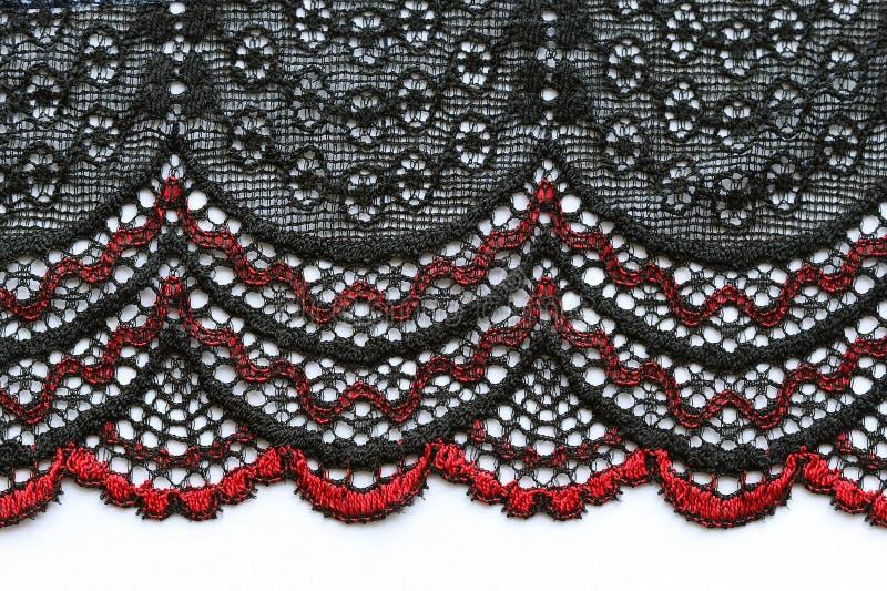 Tiro material de la macro de la textura del cordón rojo y negro de las flores imágenes de archivo libres de regalías