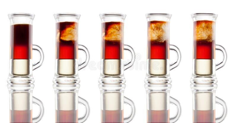 tiro Multi-mergulhado do álcool isolado no branco fotografia de stock