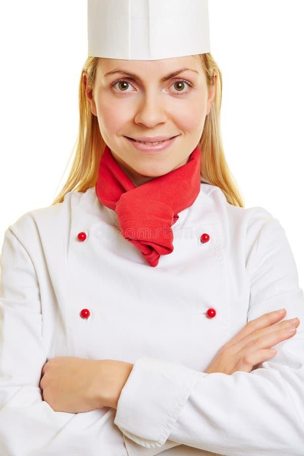 Tiro principal de uma mulher como o cozinheiro do cozinheiro chefe foto de stock