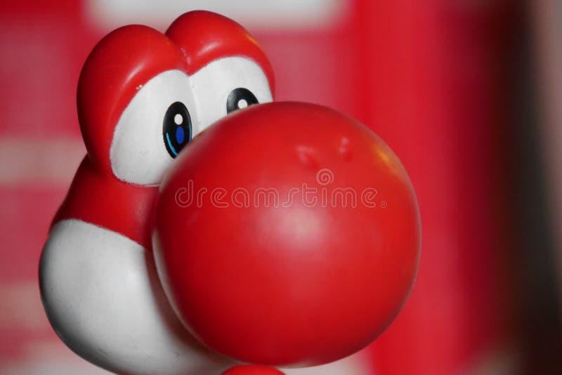 Tiro principal de Yoshi Toy vermelha plástica imagens de stock royalty free